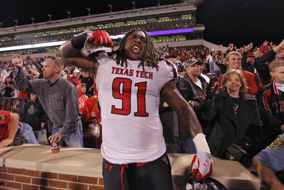 Photo - Texas Tech's Kerry Hyder (91) celebrates after the 41-38 win over Oklahoma during the college football game between the University of Oklahoma Sooners (OU) and Texas Tech University Red Raiders (TTU) at the Gaylord Family-Oklahoma Memorial Stadium on Sunday, Oct. 23, 2011. in Norman, Okla. Photo by Chris Landsberger, The Oklahoman