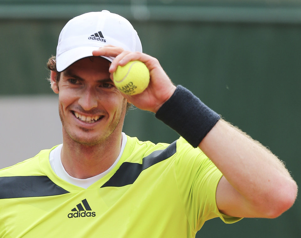 Photo - Britain's Andy Murray adjusts his cap as he plays Kazakhstan's Andrey Golubev during the first round match of  the French Open tennis tournament at the Roland Garros stadium, in Paris, France, Tuesday, May 27, 2014. Murray won 6-1, 6-4, 3-6, 6-3. (AP Photo/David Vincent)
