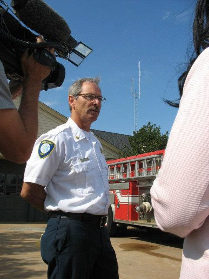Photo - Nichols Hills Assistant Fire Chief Terry Hamilton talks to the media on Wednesday in Nichols Hills.  Andrew Knittle - Andrew Knittle