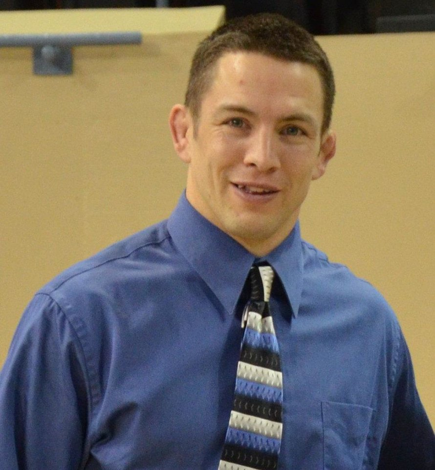 Photo - Andy Schneider, all-city wrestling coach of the year