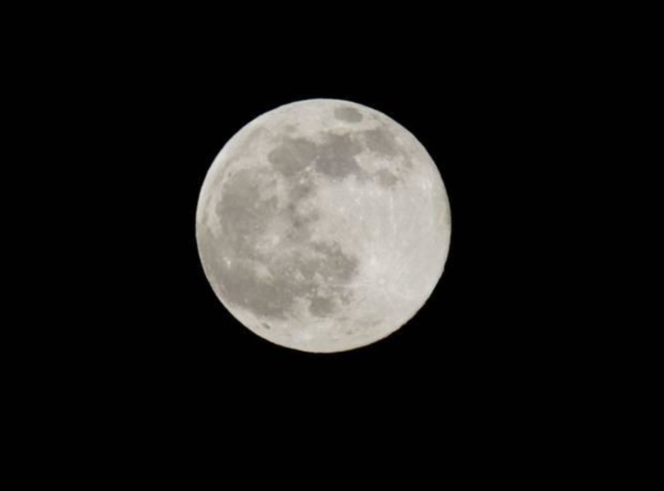 Photo - A blue moon rises Friday, July 31, 2015 as seen from Taguig city east of Manila. AP Photo