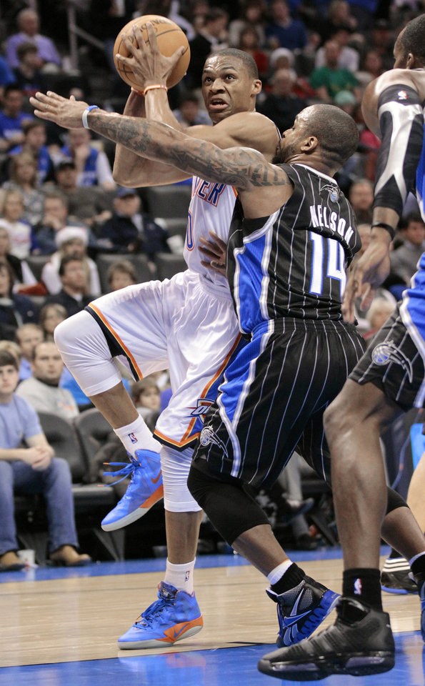 Oklahoma City Thunder's Russell Westbrook shoots guarded by Orlando Magic's Jameer Nelson (14) in the second half as the Oklahoma City Thunder defeat the Orlando Magic 97-89 in NBA basketball at the Chesapeake Energy Arena on Sunday, Dec. 25, 2011, in Oklahoma City, Okla.  Photo by Steve Sisney, The Oklahoman