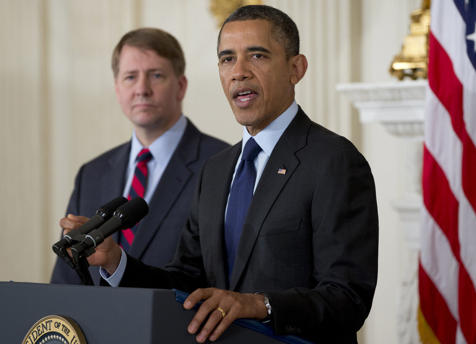 President Barack Obama announces in the State Dining Room of the White House in Washington, Thursday, Jan. 24, 2013, that he will re-nominate Richard Cordray, left, to lead the Consumer Financial Protection Bureau, a role that he has held for the last year under a recess appointment, and nominate Mary Joe White, not seen, to lead the Security and Exchange Commission (SEC). (AP Photo/Carolyn Kaster)