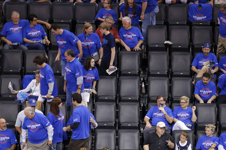 Photo - Oklahoma City fans leave the arena near the seven minute mark in the fourth quarter of Game 1 of the Western Conference semifinals in the NBA playoffs between the Oklahoma City Thunder and the Los Angeles Clippers at Chesapeake Energy Arena in Oklahoma City, Monday, May 5, 2014. Photo by Bryan Terry, The Oklahoman