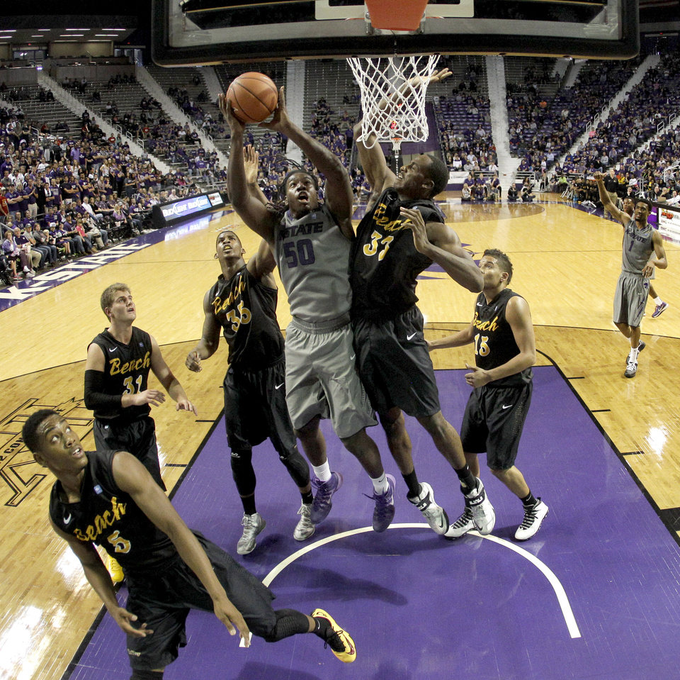 Photo - Kansas State's D.J. Johnson (50) puts up a shot during the second half of an NCAA college basketball game against Long Beach State, Sunday, Nov. 17, 2013, in Manhattan, Kan. Kansas State won 71-58. (AP Photo/Charlie Riedel)