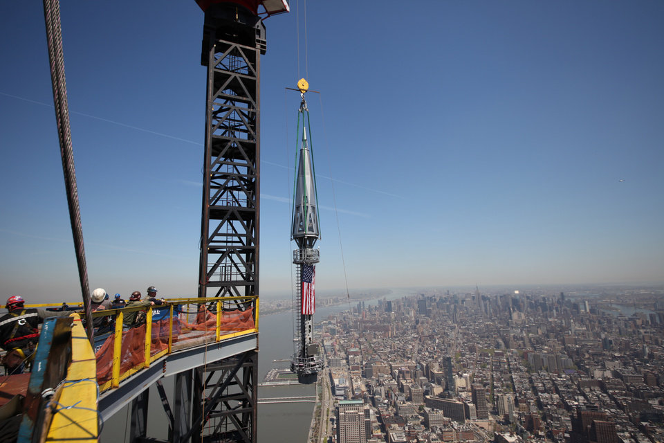 Photo - In this photo provided by the Port Authority of New York and New Jersey, one of the last two segments of the silver spire to be installed on top of One World Trade Center is hoisted to the top of the building on Thursday, May 2, 2013. With the spire as its crown, the trade center will soar to a symbolic 1,776 feet in the air, a reference to the birth of the nation in 1776. (AP Photo/Port Authority of New York and New Jersey) MANDATORY CREDIT: PORT AUTHORITY OF NEW YORK AND NEW JERSEY