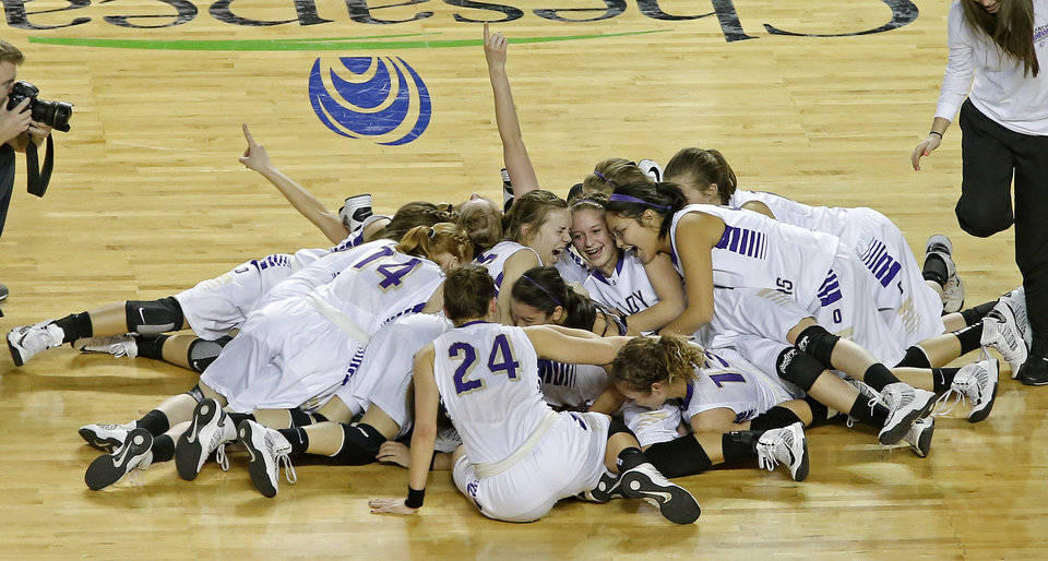 Photo - Okarche celebrates as they win the Class A girls state championship game between Okarche and Cheyenne/Reydon in the State Fair Arena at State Fair Park in Oklahoma City, Saturday, March 2, 2013. Photo by Bryan Terry, The Oklahoman