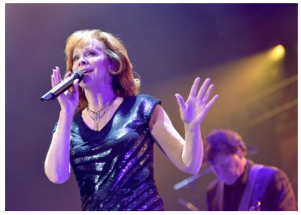 Photo - Oklahoma native Reba McEntire performs at the Country Rising benefit concert Sunday at Nashville's Bridgestone Arena. Photos provided courtesy of Getty
