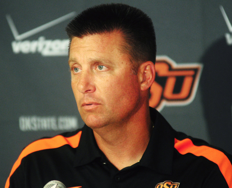 Photo - OKLAHOMA STATE UNIVERSITY / OSU / COLLEGE FOOTBALL: Oklahoma State coach Mike Gundy speaks to media members at the media luncheon on August 22, 2013 at Boone Pickens Stadium in Stillwater, Okla. Photo by KT King, For the Oklahoman