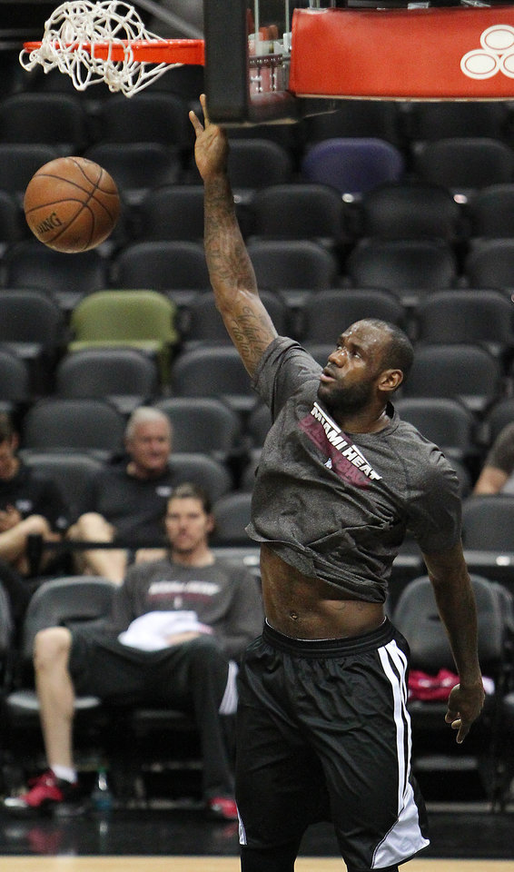 Photo - Miami Heat forward LeBron James dunks during NBA basketball practice, Saturday, June 15, 2013, in San Antonio. The Heat take on the San Antonio Spurs in Game 5 of the NBA Finals on Sunday, with the best-of-seven games series even at 2-2.(AP Photo/El Nuevo Herald, David Santiago)  MAGS OUT