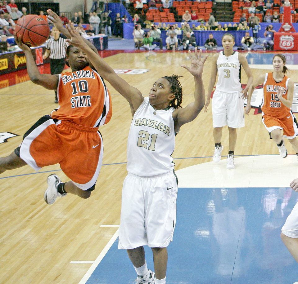 Photo - OSU's Andrea Riley tries to shoot past Baylor's Kelli Griffin during the Big 12 Women's Championship game between Oklahoma State and Baylor at the Cox Center in Oklahoma City, Friday, March 13, 2009.  OSU lost to Baylor 67-62. PHOTO BY BRYAN TERRY, THE OKLAHOMAN