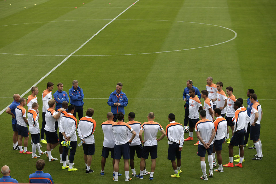 Photo - Coach Louis van Gaal, center, of the Netherlands briefs his team during a training session in Rio de Janeiro, Brazil, Friday, June 20, 2014.  The Netherlands play in group B of the 2014 soccer World Cup. (AP Photo/Wong Maye-E)