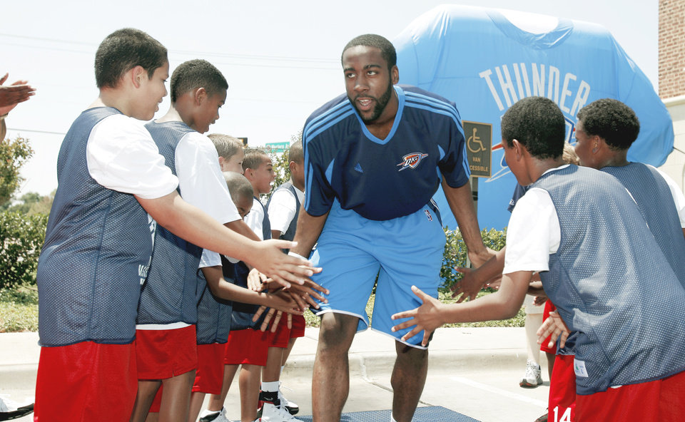 Photo - The Thunder's top pick James Harden is introduced to the fans at the Thunder Caravan on Saturday. Photo by Sarah Phipps, The Oklahoman