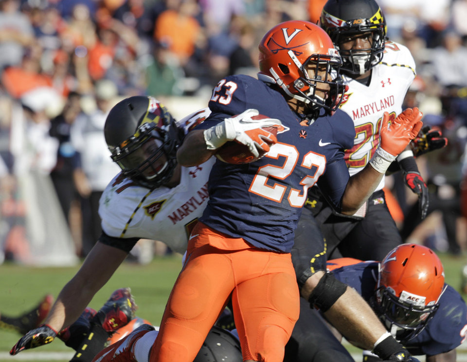 Photo -   Virginia running back Khalek Shepherd (23) looks for running room as Maryland linebacker Cole Farrand (47) tries to make the tackle during the first half of an NCAA college football game in Charlottesville, Va., Saturday, Oct. 13, 2012. (AP Photo/Steve Helber)