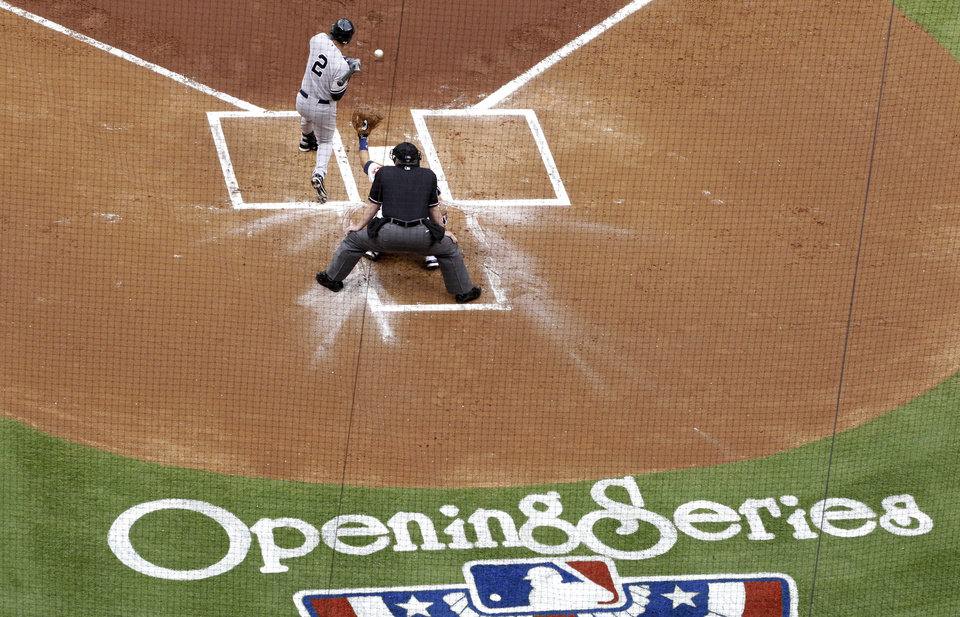 Photo - New York Yankees' Derek Jeter is hit by a pitch in the first inning of a baseball game against the Houston Astros, Tuesday, April 1, 2014, in Houston. (AP Photo/Patric Schneider)