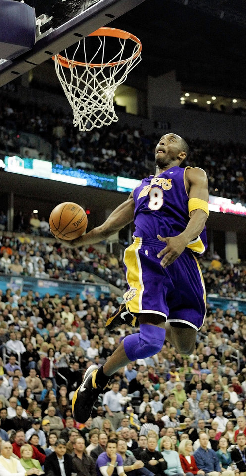 Photo - Kobe Bryant of the Los Angeles Lakers dunks during a February 2006 game against the New Orleans/Oklahoma City Hornets in the then-Ford Center in Oklahoma City. (By Nate Billings, The Oklahoman)