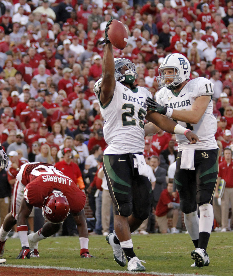Photo - Baylor's Lache Seastrunk (25) and Nick Florence (11) react after Seastrunk's touchdown during the college football game between the University of Oklahoma Sooners (OU) and Baylor University Bears (BU) at Gaylord Family - Oklahoma Memorial Stadium on Saturday, Nov. 10, 2012, in Norman, Okla.  Photo by Chris Landsberger, The Oklahoman