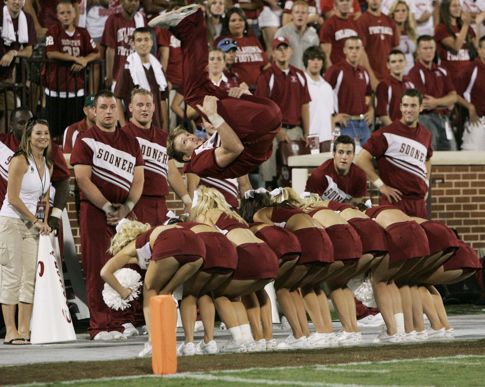 Photo - Oklahoma cheerleader Zach Houchin flips over 10 other cheerleaders in the fourth quarter during the University of Oklahoma Sooners (OU) college football game against the University of North Texas Mean Green (UNT) at the Gaylord Family - Oklahoma Memorial Stadium, on Saturday, Sept. 1, 2007, in Norman, Okla.