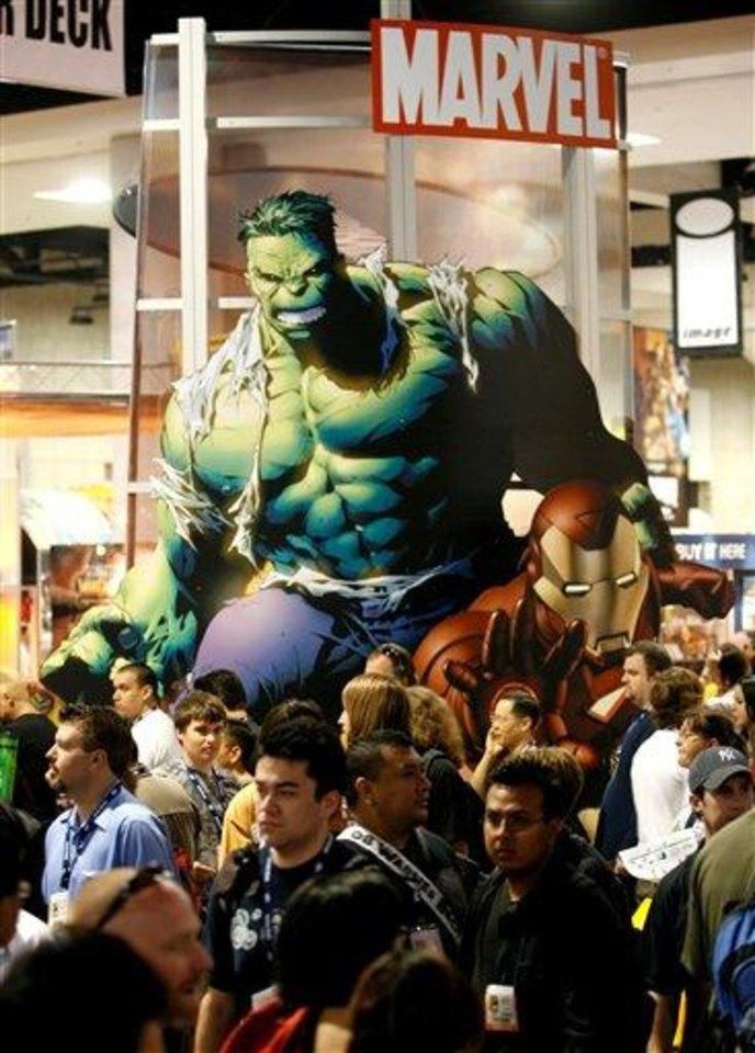 "In this July 24, 2008 file photo, Marvel Comics ""Incredible Hulk"" looms over attendees at the Comic-Con 2008 convention in San Diego. The Walt Disney Co. said Monday, Aug. 31, 2009, it is buying Marvel Entertainment Inc. for $4 billion in cash and stock, bringing characters like Iron Man and Spider-Man into the family of Mickey Mouse and WALL-E.(AP Photo/Denis Poroy, file)"