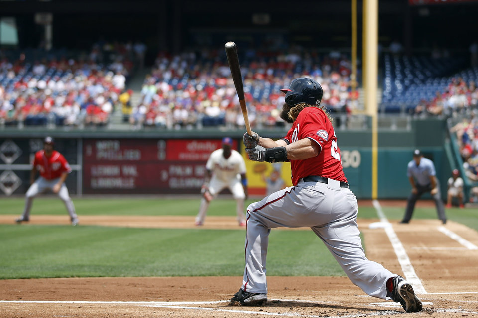 Photo - Washington Nationals' Jayson Werth follows through after hitting a three-run home run off Philadelphia Phillies starting pitcher Kyle Kendrick during the first inning of a baseball game, Sunday, July 13, 2014, in Philadelphia. (AP Photo/Matt Slocum)
