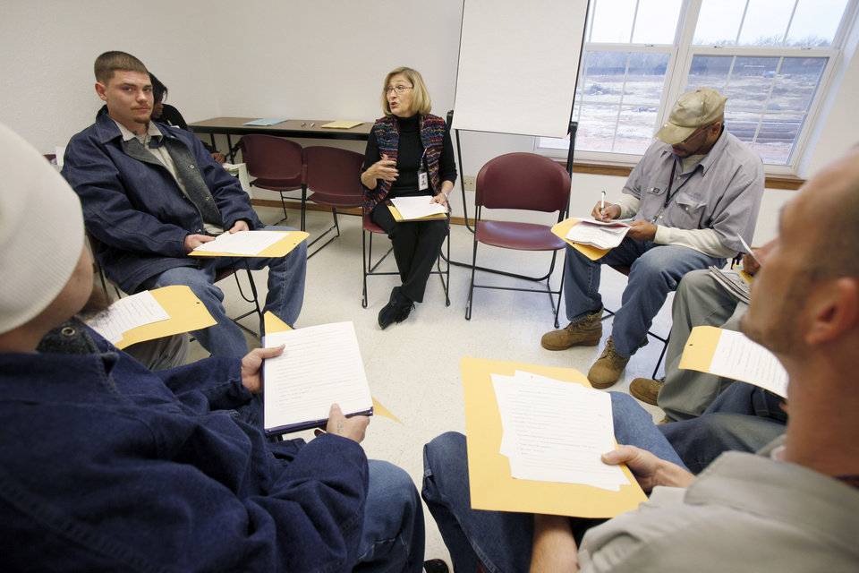 Cheri Fuller gives instructions to inmates on creating their Christmas messages, as the Oklahoma Message Project videotapes the Christmas messages of incarcerated men at Clara Waters CCC in Oklahoma City, OK, Tuesday, Dec. 13, 2011. By Paul Hellstern, The Oklahoman