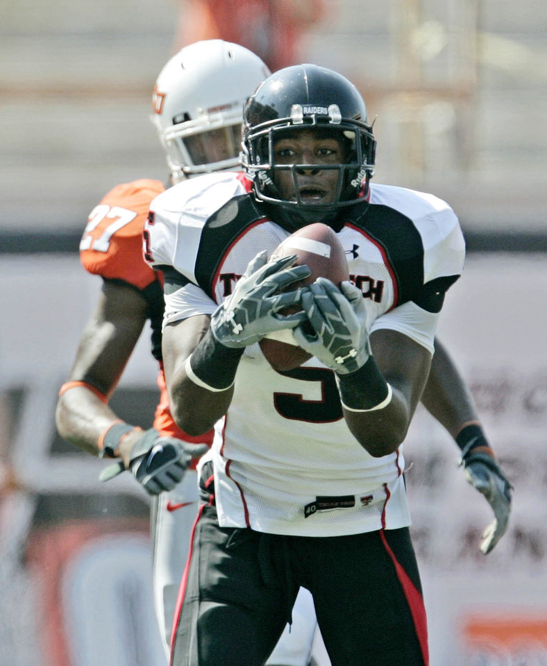 Photo - COLLEGE FOOTBALL: Texas Tech University wide receiver Michael Crabtree ORG XMIT: OKC0808161149193131
