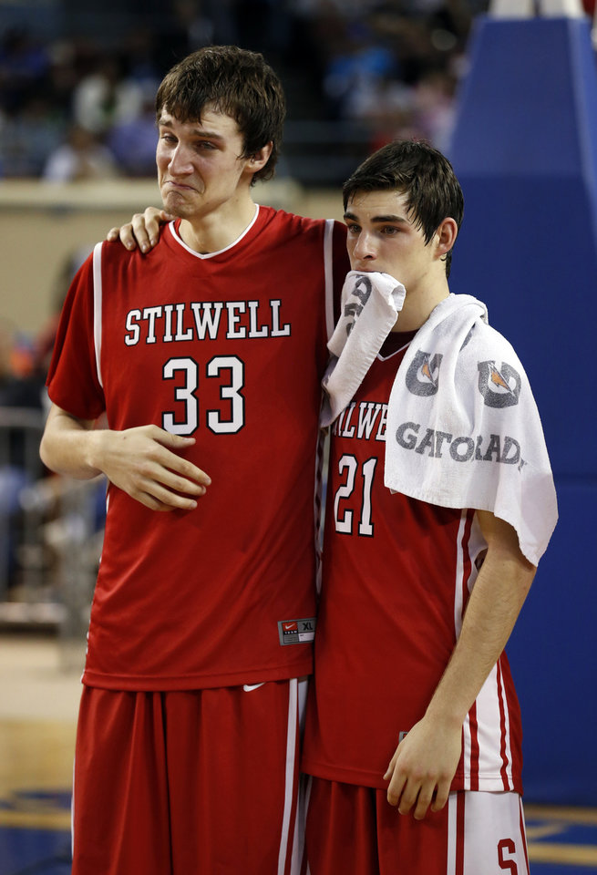 Photo - Stilwell players Matt Lea (33) and Chase Littlejohn console each other as Douglass defeats the Stilwell Indians 78-50 in the finals of the State Class 4A Boys Basketball Tournament at the Fairgrounds Arena on Saturday, March 15, 2014, in Oklahoma City, Okla. Photo by Steve Sisney, The Oklahoman