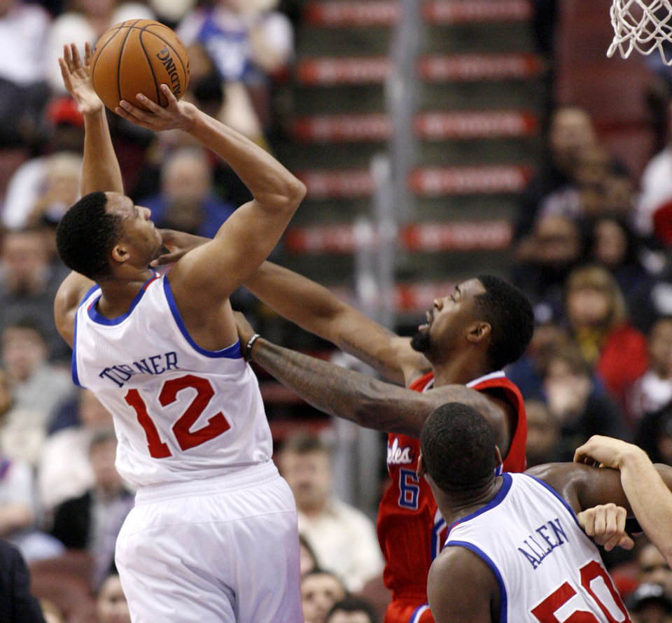 Philadelphia 76ers' Evan Turner (12) shoot over Los Angeles Clippers' DeAndre Jordan (6) in the first half of an NBA basketball game, Monday, Feb. 11, 2013, in Philadelphia. (AP Photo/H. Rumph Jr)