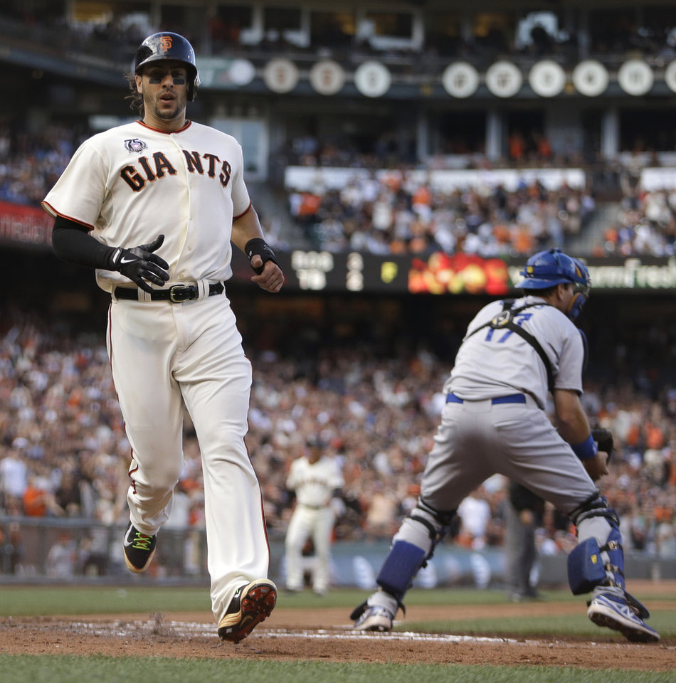 Photo - San Francisco Giants' Michael Morse, left, scores behind Los Angeles Dodgers catcher A.J. Ellis in the fourth inning of a baseball game Sunday, July 27, 2014, in San Francisco. Morse scored on a single by Brandon Crawford. (AP Photo/Ben Margot)