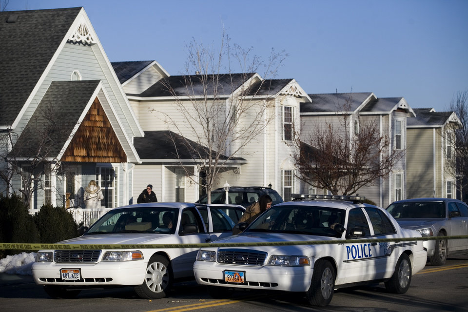 Photo - Police gather outside a home, Friday, Jan. 17, 2014, in Spanish Fork, Utah where five people were found dead on Thursday.  A 34-year-old officer shot and killed his wife, mother-in-law and two young children and turned the gun on himself, authorities said Friday.  Spanish Fork police said the five were found dead about 11 p.m. Thursday, when co-workers reported Joshua Boren didn't show up for his night shift as a patrol officer at the Lindon Police Department. (AP Photo/Daily Herald, Mark Johnston)