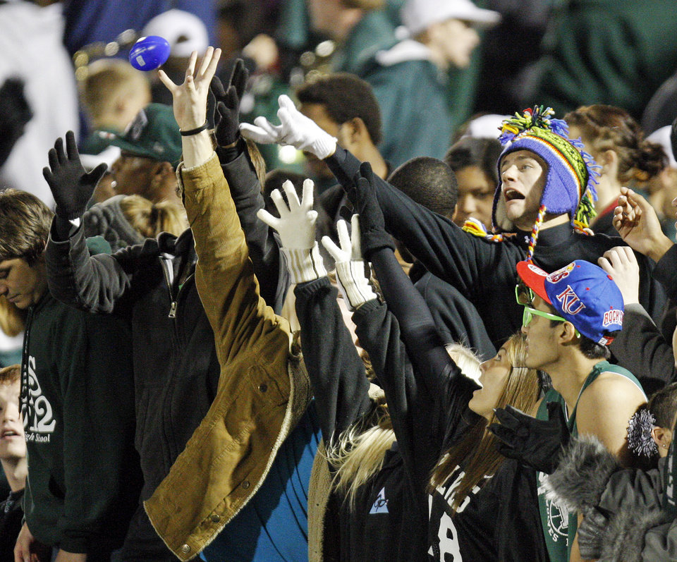 Photo - Edmond Santa Fe fans try to catch a toy football thrown into the crowd during a high school football game between Edmond Santa Fe and Edmond North at Wantland Stadium in Edmond, Okla., Friday, Oct. 28, 2011. Photo by Nate Billings, The Oklahoman