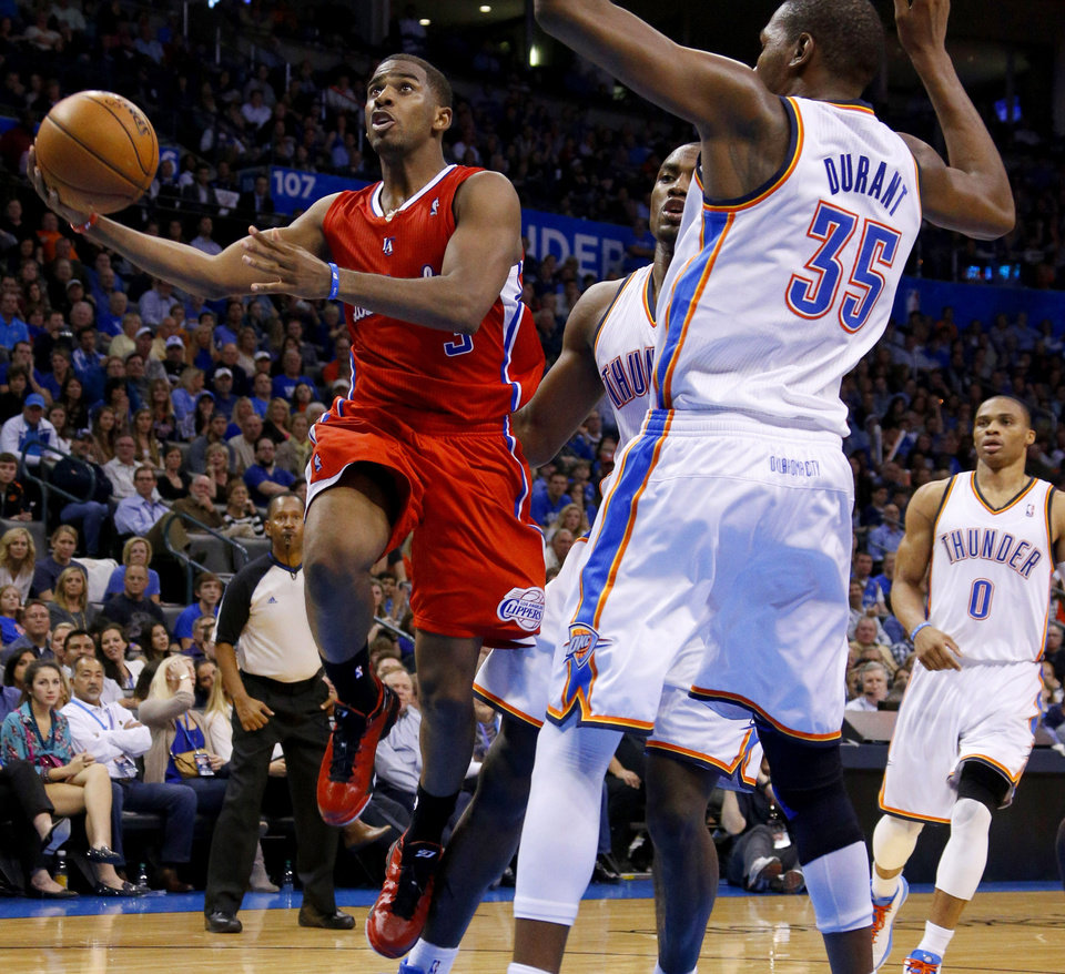 The Clippers Chris Paul (3) goes past Oklahoma City's Kevin Durant (35) during an NBA basketball game between the Oklahoma City Thunder and the Los Angeles Clippers at Chesapeake Energy Arena in Oklahoma City, Wednesday, Nov. 21, 2012. Photo by Bryan Terry, The Oklahoman