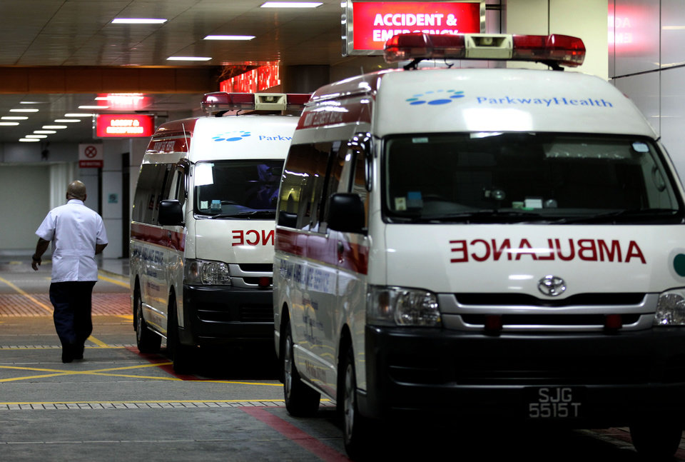 "Ambulances are parked outside the accident and emergency entrance at Mount Elizabeth Hospital in Singapore, late Friday Dec. 28, 2012. After 10 days at a New Delhi hospital, the victim of a gang-rape in New Delhi was flown to Singapore on Thursday for treatment at the Mount Elizabeth hospital. The young woman's condition had ""taken a turn for the worse"" and her vital signs had deteriorated with indications of severe organ failure, said Dr. Kelvin Loh, the chief executive officer of Singapore's Mount Elizabeth hospital. (AP Photo/Wong Maye-E)"