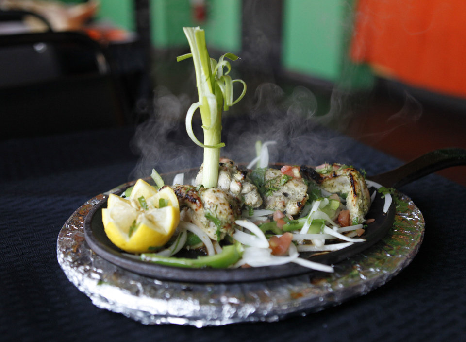 Chicken Hariyali Kabob is served on a sizzling platter at Heritage India, a new Indian restaurant in Edmond. <strong>PAUL HELLSTERN - Oklahoman</strong>