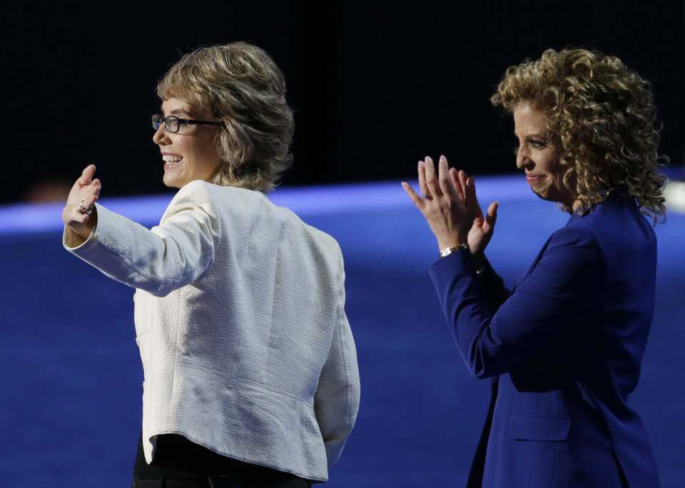 Photo -   Former Rep. Gabrielle Giffords, left, walks with Democratic National Committee Chairwoman Rep. Debbie Wasserman Schultz, from Florida, to recite the Pledge of Allegiance the Democratic National Convention in Charlotte, N.C., on Thursday, Sept. 6, 2012. (AP Photo/Lynne Sladky)