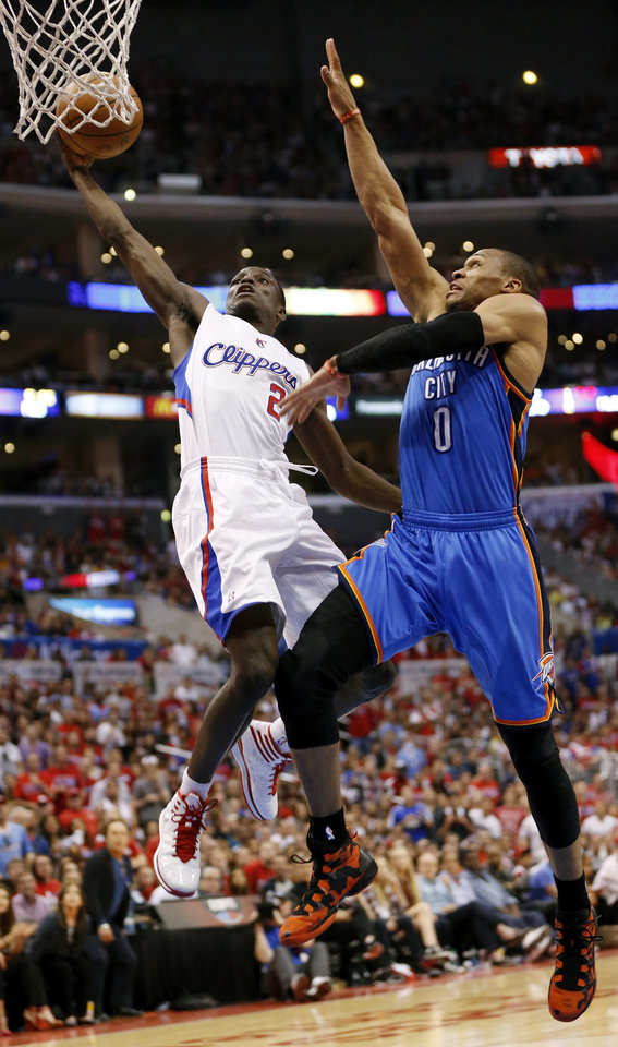 Photo - Los Angeles' Darren Collison (2) takes the ball to the hoop against Oklahoma City's Russell Westbrook (0) in the fourth quarter during Game 4 of the Western Conference semifinals in the NBA playoffs between the Oklahoma City Thunder and the Los Angeles Clippers at the Staples Center in Los Angeles, Sunday, May 11, 2014. Westbrook picked up his fifth foul on the play. The Clipper won 101-99. Photo by Nate Billings, The Oklahoman