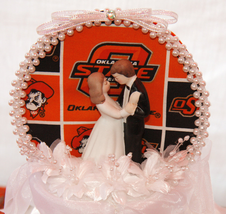 The wedding cake for Cowboy fans Scott Stuart and Yvonne Marsh who got married before the college football game between the University of Oklahoma Sooners (OU) and Oklahoma State University Cowboys (OSU) at Boone Pickens Stadium on Saturday, Nov. 29, 2008, in Stillwater, Okla. 