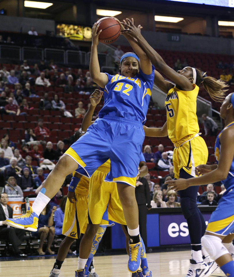 UCLA's Alyssia Brewer (32) grabs a rebound in front of California's Gennifer Brandon in the first half of an NCAA college basketball game in the Pac-12 Conference tournament Saturday, March 9, 2013, in Seattle. (AP Photo/Elaine Thompson)