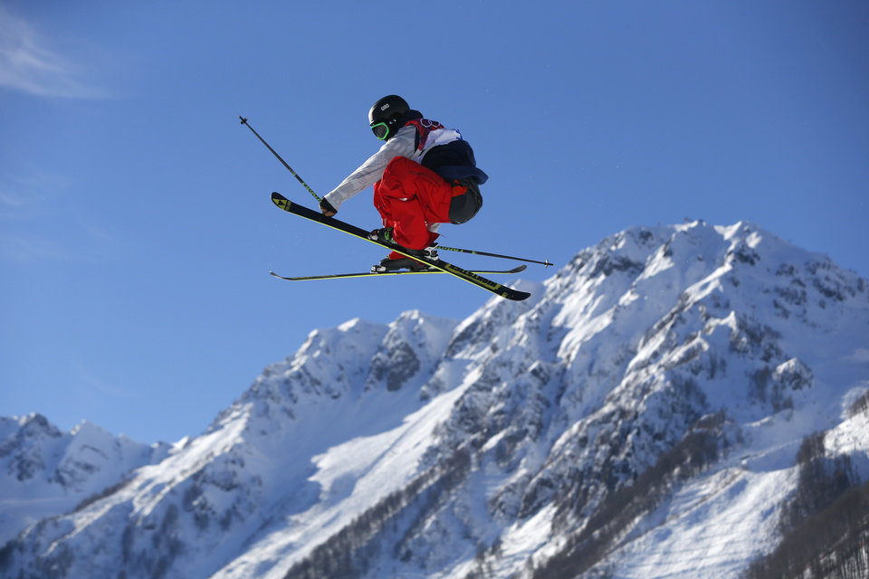 Photo - Joss Christensen of the United States competes in the men's ski slopestyle qualifying at the Rosa Khutor Extreme Park, at the 2014 Winter Olympics, Thursday, Feb. 13, 2014, in Krasnaya Polyana, Russia. (AP Photo/Sergei Grits)