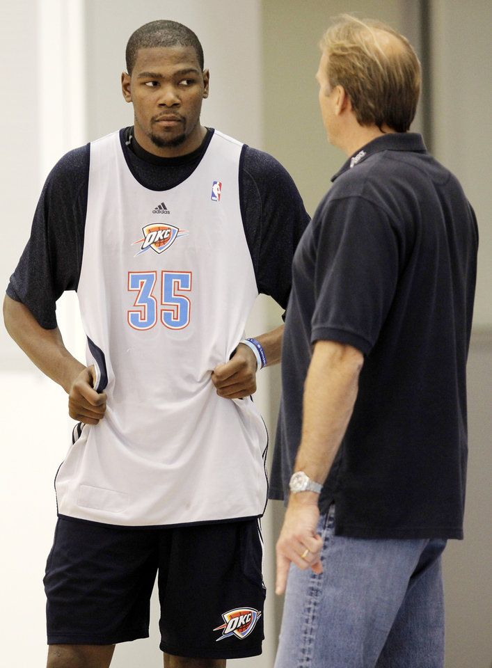 Photo - Kurt Rambis works one-on-one withthe Thunder's  Kevin Durant at the end of a practice session at the Thunder Practice Facility, Wednesday, Dec. 14, 2011. Photo by Doug Hoke, The Oklahoman