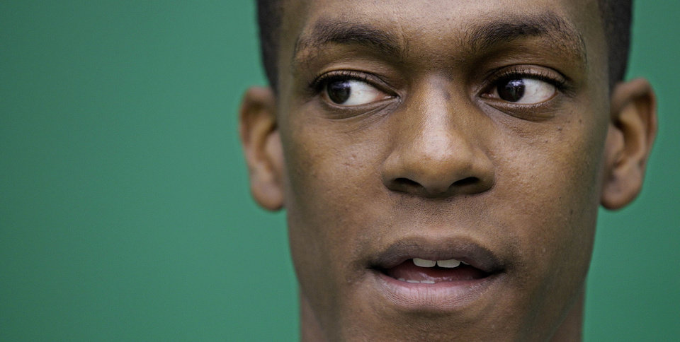 Photo -   Boston Celtic guard Rajon Rondo answers a reporter's question during media day at the NBA basketball team's training center in Waltham, Mass., Friday, Sept. 28, 2012. (AP Photo/Stephan Savoia)