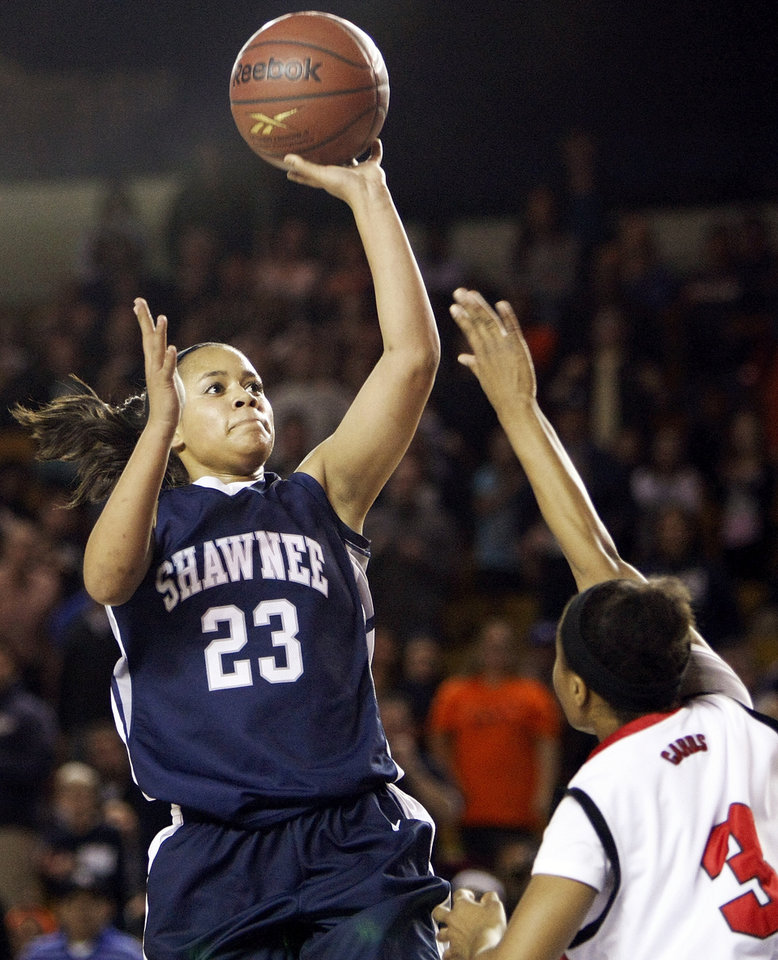 Photo - Shawnee's Kelsee Grovey (23) shoots over East Central's Janee Arnod (3) during the Class 5A girls high school basketball state tournament championship game between Shawnee and East Central at the Mabee Center in Tulsa, Okla., Saturday, March 10, 2012. Shawnee won, 45-41. Photo by Nate Billings, The Oklahoman