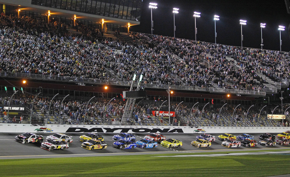 Photo - Austin Dillon (3) and Greg Biffle (16) lead the field at the start of the first of two NASCAR Sprint Cup series qualifying auto races at Daytona International Speedway in Daytona Beach, Fla., Thursday, Feb. 20, 2014. (AP Photo/Terry Renna)