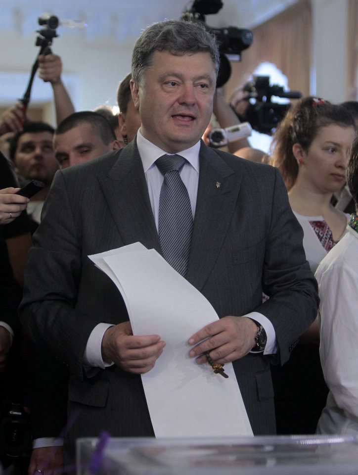Photo - Ukrainian presidential candidate Petro Poroshenko casts his ballot at a polling station during the presidential election in Kiev, Ukraine, Sunday, May 25, 2014. Ukraine's critical presidential election got underway Sunday under the wary scrutiny of a world eager for stability in a country rocked by a deadly uprising in the east.(AP Photo/Sergei Chuzavkov)