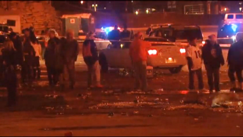 Photo - In this image from television provided courtesy of KMGH-THEDENVERCHANNEL.COM people mill around the area where at least three people were stabbed Thursday night Dec. 12, 2013 in a parking area at at Sports Authority Stadium Field at Mile High after the Denver Broncos' game. (AP Photo/KMGH-The Denverchannel.com) DENVER OUT