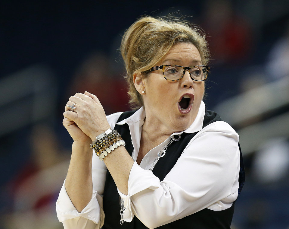 Photo - Vanderbilt head coach Melanie Balcomb argues with an official in the first half of a second-round women's Southeastern Conference tournament NCAA college basketball game against Georgia, Thursday, March 6, 2014, in Duluth, Ga.  (AP Photo/John Bazemore