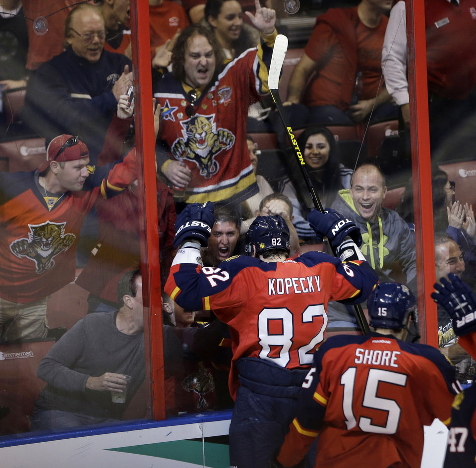 Fans celebrate with Florida Panthers' Tomas Kopecky (82) after he scored a goal against the Boston Bruins during the first period of an NHL hockey game in Sunrise, Fla., Sunday, Feb. 24, 2013. (AP Photo/J Pat Carter)
