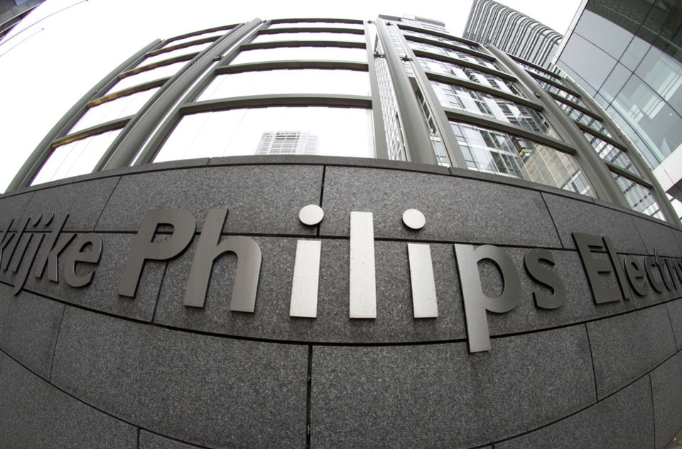Exterior view of the headquarters of Philips in Amsterdam, Netherlands, Tuesday Jan. 29, 2013. Royal Philips Electronics NV Tuesday said it will sell the entertainment division which contains many of the consumer products for which it is best known, such as audio and video equipment, to Funai Electric Co., Ltd., of Japan for Euros 150 million (USD 202 million) plus licensing fees. Funai will assume responsibility for the manufacturing of the Philips products but license and sell them under the Philips brand for five years. It has an option to renew. (AP Photo/Peter Dejong)
