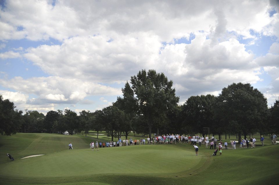 Photo - Spectators gather around the sixth green to watch Michael McCoy putt, during the U.S. Mid-Amateur Championship golf tournament at Country Club of Birmingham on Thursday, Oct. 10, 2013. McCoy defeated Bill Williamson 8 and 6. (AP Photo/AL.com, Frank Couch) MAGS OUT