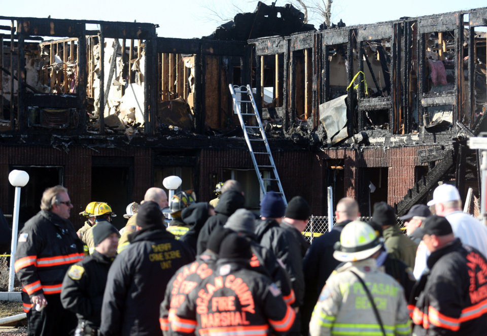Firefighters investigate an early morning fire at the Mariner\'s Cove Hotel in Point Pleasant Beach, N.J. on Friday, March 21, 2014. An early morning fire killed three people at the Jersey shore motel whose residents included Superstorm Sandy victims who were staying there because their homes remain uninhabitable nearly a year and a half after the storm, officials said. Three other people were critically injured in the blaze. Authorities said several other people may be unaccounted for. Investigators are interviewing motel management to determine how many people were staying there when the fire broke out. The motel\'s office was destroyed and most records were lost. (AP Photo/David Gard)